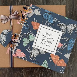 hen party scrapbook with a butterfly background design and a kraft gift box